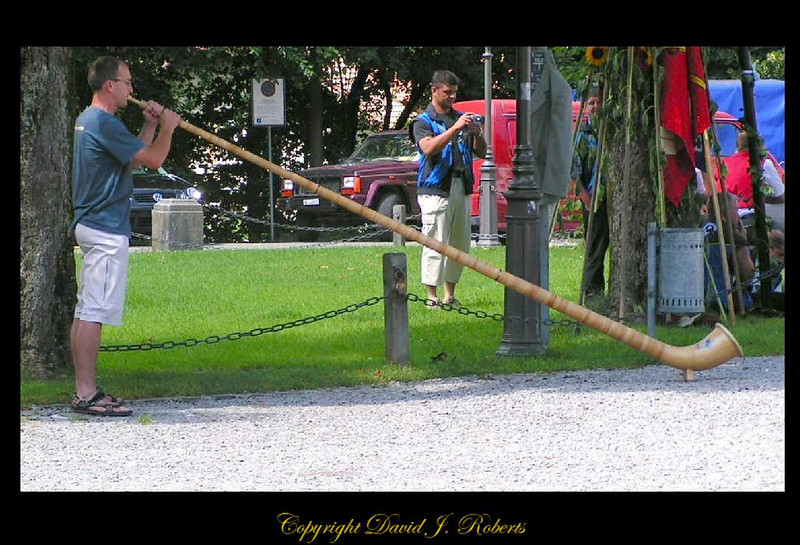 Alphorn blower in Einsiedeln, Switzerland