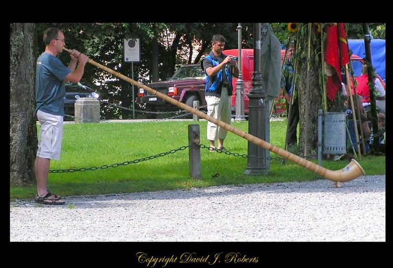 Alphorn blower in Einsiedeln, Switzerland