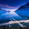 Europe - Switzerland - Swiss - Graubünden Canton - Grisons - Alps - Alpen - Alpi - Alpes - Great Mountain Range in Europe - Lago Bianco - White Lake - Iconic water reservoir at Bernina pass - Alpine mountain lake at 2,253 metres above sea level - Winter snowy landscape with deep frozen lake and long ice cracks