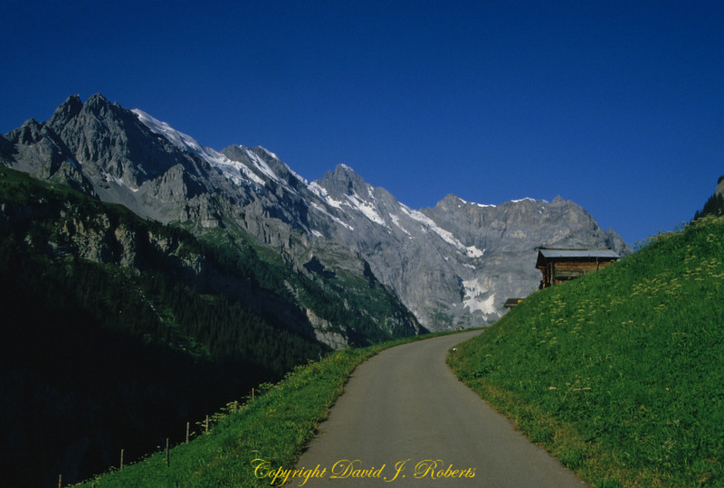 Trail leads to the mountains from Gimmelwald, Switzerland