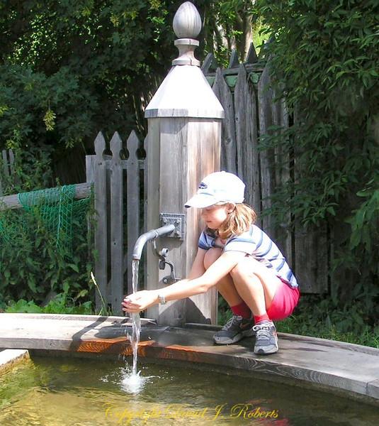 Rachel at a well, Engadine, Switzerland