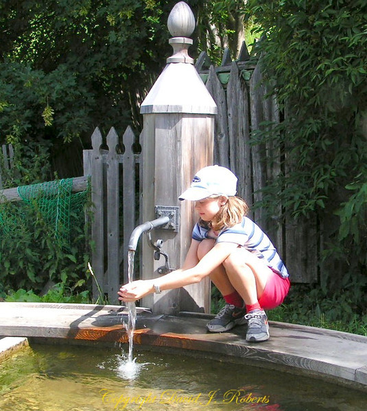 Rachel at a well, Engadine, Switzerland