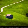Switzerland - Swiss - The Alps - Alpen - Alpi - Alpes - Great Mountain Range in Europe - Lonely hut on green grass field