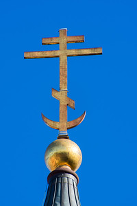 We were told that the Russian Orthodox cross has two crosses at the top, one for the sign that said King of the Jews. The crocked cross at the bottom is were Jesus' feet were, and the crescent with the cross through it represents Christianity's defeat of Islam.