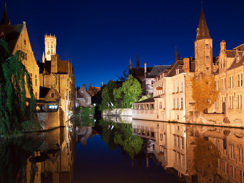 One of the main canals at night with nice reflections from the water. The landmark carillon, or belltower, at Market Square is visible in the upper left.
