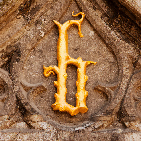 An ornate golden carving of the letter B is located in the town of Bruges in Belgium. Coincidentally, it is also over the doorway of the Basilius or the Basilica of the Holy Blood