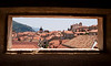 A view of the roofs of Dubrovnik (Croatia) through a narrow window in one of the forts on the wall that circles the old town.
