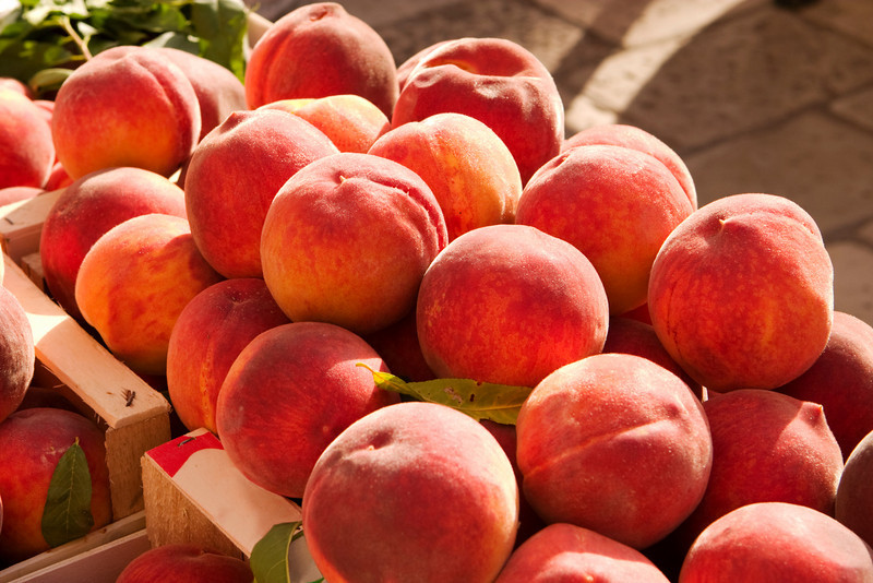 A box of juicy, ripe peaches for sale at the Dubrovnik farmer's market.