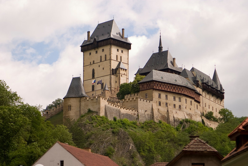 Karlstein Castle was the country seat for King Charles IV of Bohemia and the Holy Roman Empire. This medieval castle is located at the top of a hill.