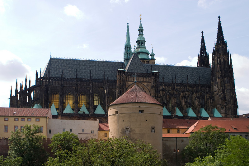 Prague Castle (Czech: Pražský hrad) and the upper portion of St. Vitus cathedral are outlined against the sky. Prague Castle sits above the city of Prague. It is where the Czech kings, Holy Roman Emperors and presidents of Czechoslovakia and the Czech Republic have had their offices. Prague Castle is one of the biggest castles in the world at about 570 meters in length and an average of about 130 meters wide. The history of the castle stretches back to the 9th century (870) and it has been under construction in one form or another since then.