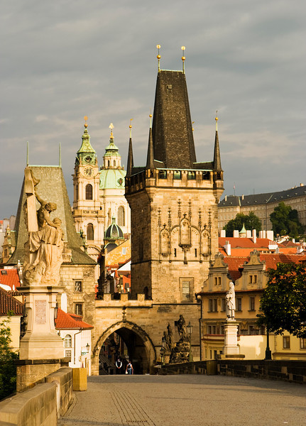 A view of Prague looking along the Charles Bridge towards the Old Town and the Hradcany castle.