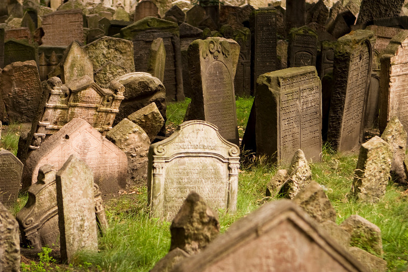 A view of the old Jewish cemetery in Prague. The tombstones are uneven due to age.