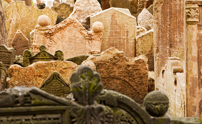 Gravestones in the historic cemetery in the Josefov ghetto area of central Prague tilt and lean together as they have settled over centuries.