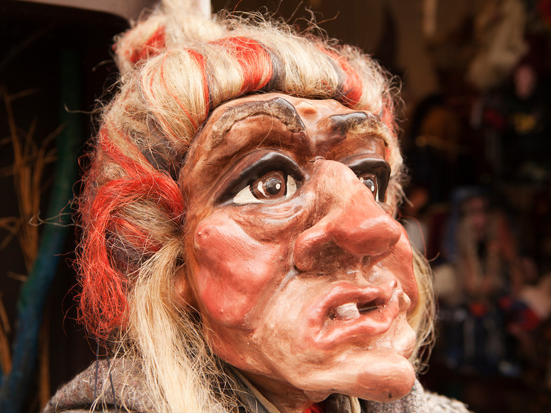 A near-lifesize head of a traditional Czech marionette in the likeness of a witch.