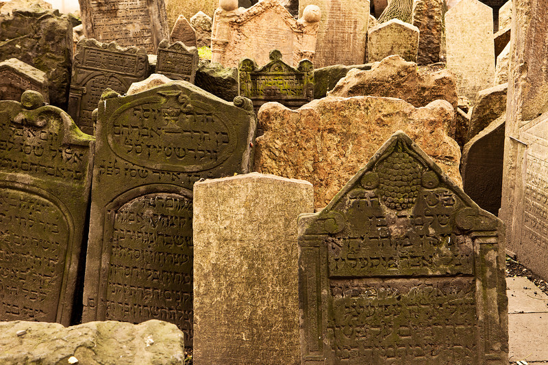 A section of the old Jewish cemetery in the Josefov section of Prague. The many grave markers are jumbled together in an uneven pattern due to the age of the stones and the settling of the ground.