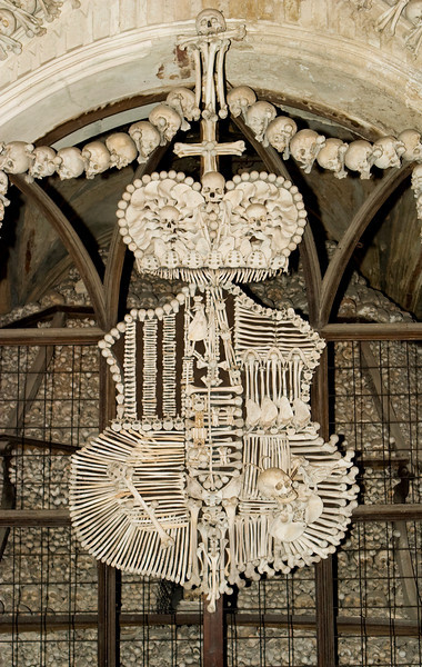 Human bones (skulls, femurs, hips, etc) formed into a famnily coat of arms at the Kostnice ossuary (Bone Church) in Kutna Hora in the Czech Republic. This somewhat macabre display is formed into the Schwarzenberg family coat of arms and uses most of the human skeleton in one piece.