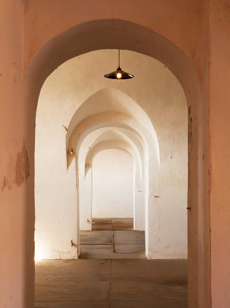An interior hallway with repeating arches in one of the guards' barracks of the World War II German prison camp at Terezin in Czechoslovakia. Now empty, the building is used for exhibits.