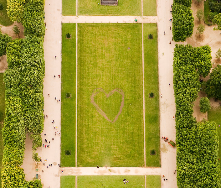 A heart shape has been walked into the grass lawns of the Parc du Champ de Mars under the Eiffel Tower, signifying love and romance in Paris.
