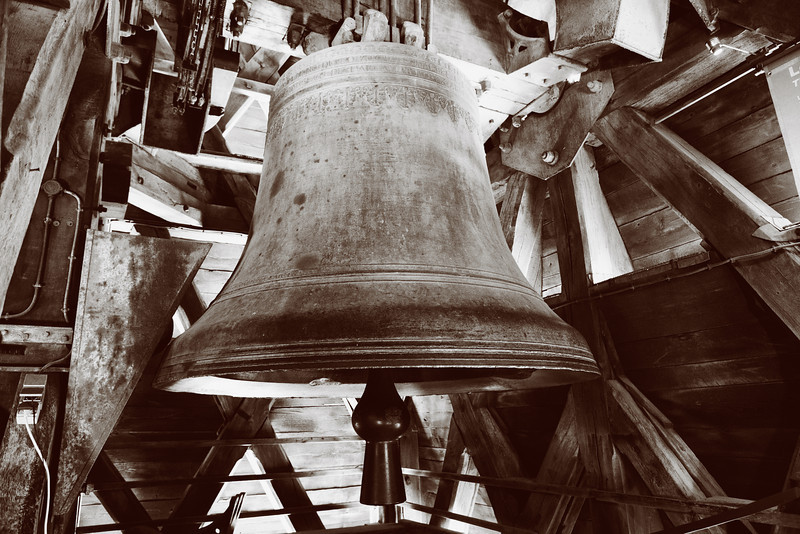 One of the old bells in the bell tower of the Notre Dame Cathedral in Paris. (Monochrome, in black and white and toned in sepia.)
