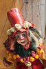 A puppet in a tall red hat is a bit of folk art as seen on the island of Santorini in Greece.