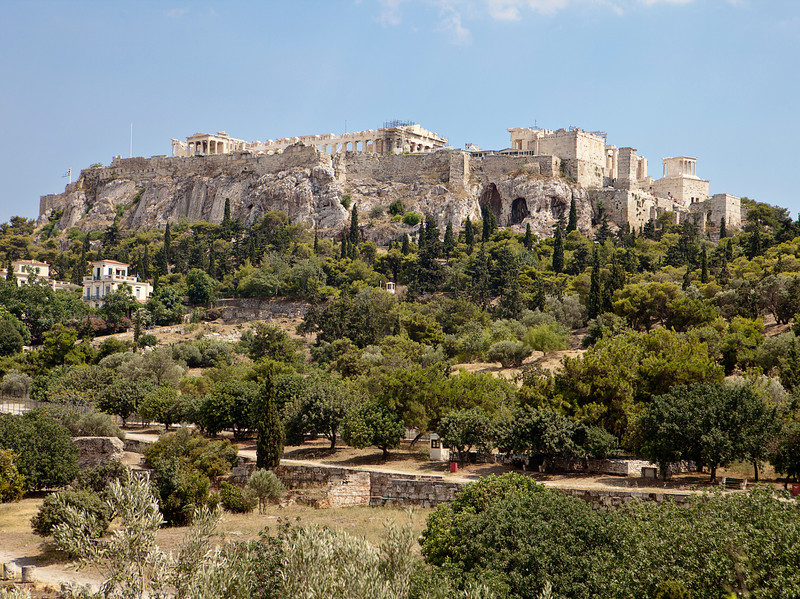 A view of the Acropolis of Athens as viewed from the Agora. The ruins of the Parthenon are just visible over the top of the cliffs.