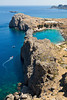 A blue lagoon near the town of Lindos on the Greek island of Rhodos highlights the deep blue waters.