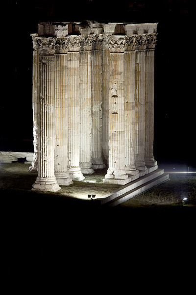 A nighttime photograph of the Temple of Zeus in Athens uses the dramatic lighting to highlight the columns that remain as part of the temple.