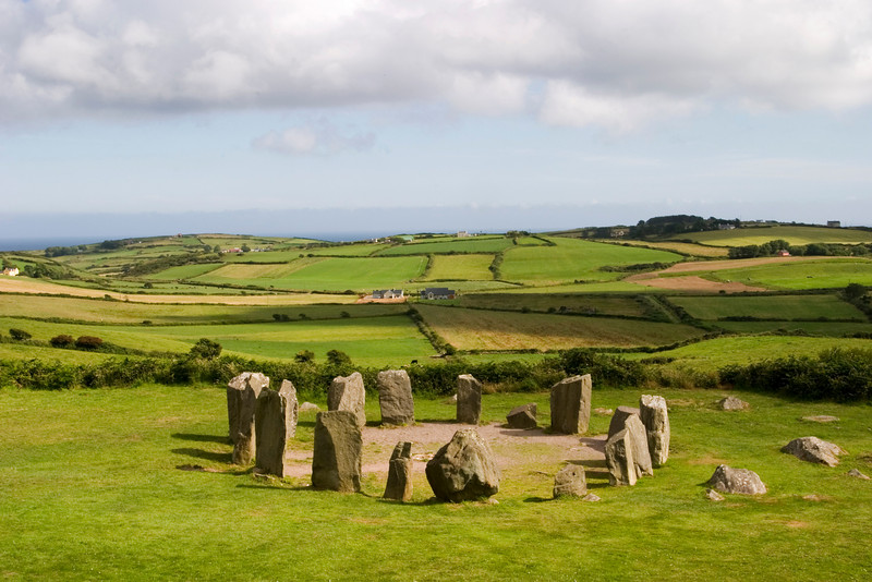 An ancient stone circle at Dombeg in County Cork in the southern part of Ireland. Stone circles were characteristic of the Bronze Age Celtic culture. Stone circles were often used for astronomical purposes although some believe that they might have been burial tombs.