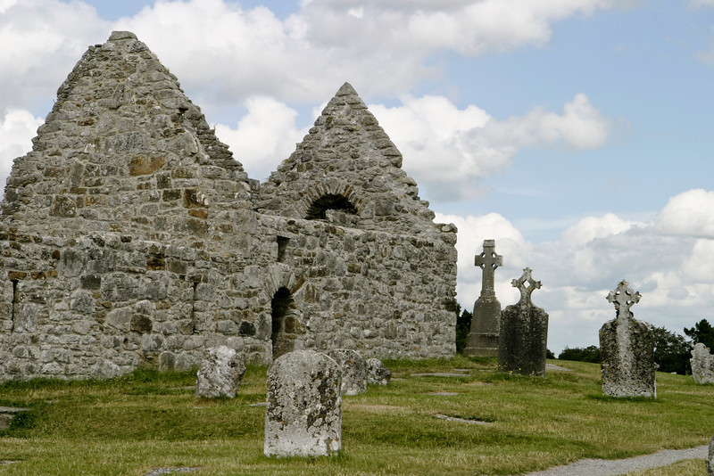 The ruins of St. Kieran's cathedral at Clonmacnoise in situated in County Offaly, Ireland on the River Shannon. The original church and monastery was built in 545 by Saint Kieran or St. Ciarán. The building is surrounded by an old cemetery with Gaelic headstones showing the traditional cross in a circle.