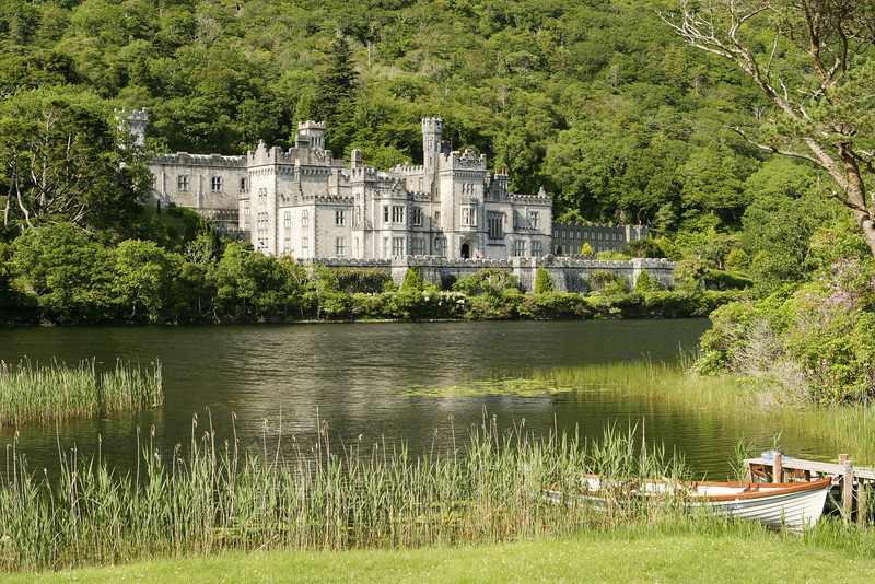 An Irish castle in the countryside. Located next to a lake, this was originally the residence for Irish nobility and is now a convent and girls' school. The white skiff in the foreground is common.