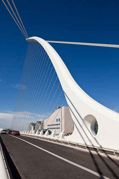 The cables and superstructure of the Samuel Beckett Bridge soar overhead in Dublin, Ireland.