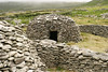 A medieval beehive stone house on the Dingle Peninsula in Western Ireland. This traditional stone construction used rocks to make safe, watertight homes.