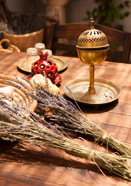 A still life with two bunches of lavender, a bronze metal spice box and other items as seen in a table in Zefat, Israel.