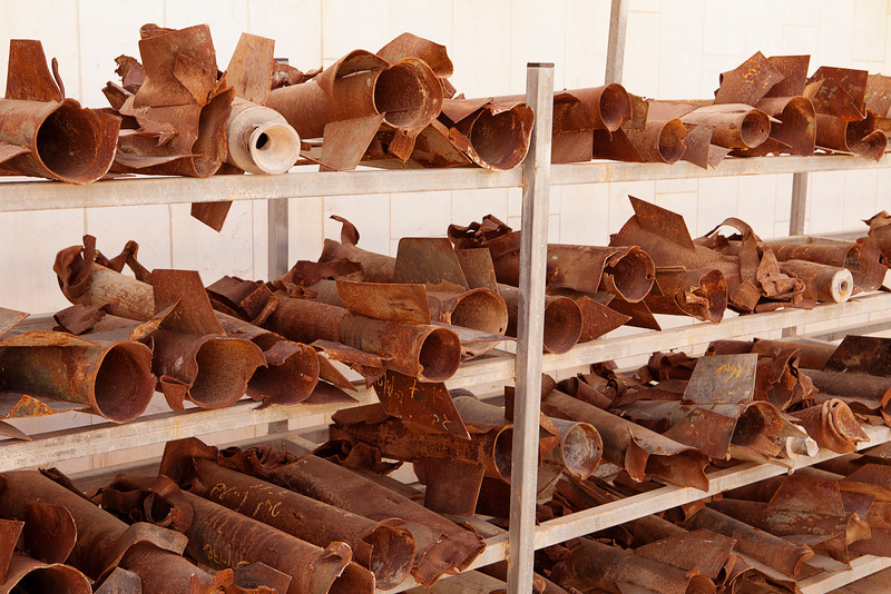 Racks of metal fragments left over from home-made rockets fired from Gaza at the police station in Sderot, Israel.