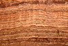 Layers of sandstone deposited over time show the geological stratification that took place over eons of history in the Negev Desert in Israel.