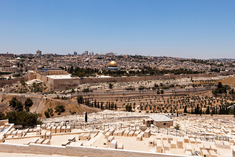 A cityscape of the Old City of Jerusalem from the cemetery on the Mount of Olives. The Islamic mosque of the Dome of the Rock is in the center with the gold dome.