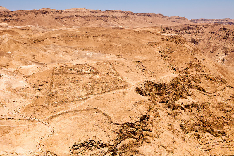 The square outline of the ruins of one of the ancient Roman forts that surround the Hebrew fortress of Masada in the mountainous desert of southern Israel.