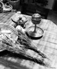 Still life photograph showing two bundles of dried lavender with a metal spice box designed to gradually release the aroma. (Scanned from black and white film.)