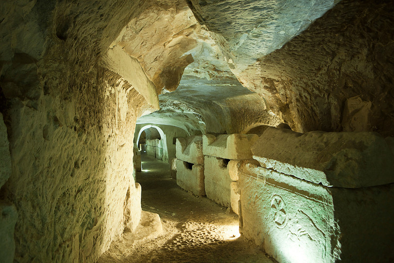 A series of large stone coffins or sarcophagi line the walls of an extensive series of tunnels carved into the soft chalk or limestone of the burial area near Bet She'arim in Israel.
