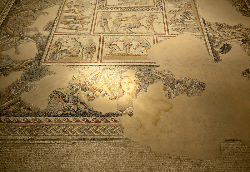 A patch of sunlight illuminates the mosaic of the head of Dionysus in the ancient Roman villa in the historic city of Zippori in Israel.