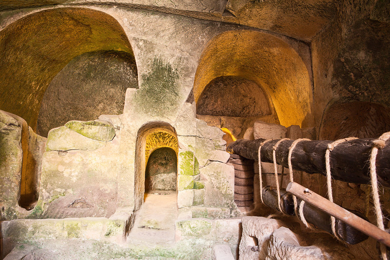 An underground cavern at Bet Guvrin in Israel containing the stone chambers of an ancient press used to make olive oil.