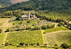 A scenic viewpoint of an old monastery estate surrounded by olive orchards and vineyards in the hilly countryisde of Umbria near Orvieto in Italy.