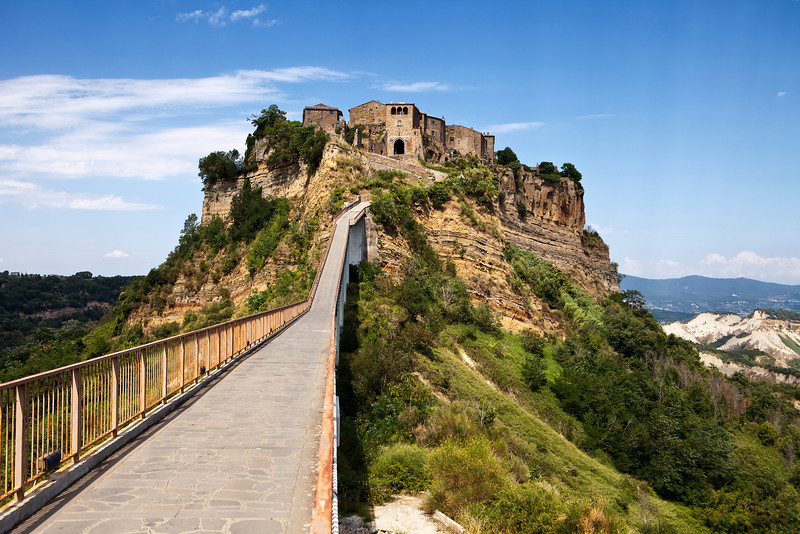 The passenger bridge crosses a long gully and is the only way to visit the hill town of Civita, Italy.