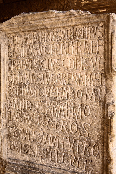 A stone tablet on display underneath the Colisseum in Rome. The inscription recalls the repairs made at his own expense by Decius Marius Venantius Basilius to the structure of the Coliseum after an earthquake. Probably dating back to 484 or 508. The inscription contains the text: DECIVS MARIVS VENANTIVS BASILIVS V[IR] C[LARISSIMVS] ET INL[VSTRIS] PRAEF[ECTVS] VRB[I] PATRICIVS CONSVL ORDINARIVS ARENAM ET PODIVM QVAE ABOMI NANDI TERRAEMO TVS RVINA PROS TRAVIT SVMTV PRO PRIO RESTITVIT