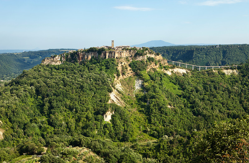 The medieval Italian hill town of Civita has been near isolated through earthquakes. The pedestrian bridge, as viewed from the town of Lubriano across the valley, is the only link from the clifftop village to the nearest town.