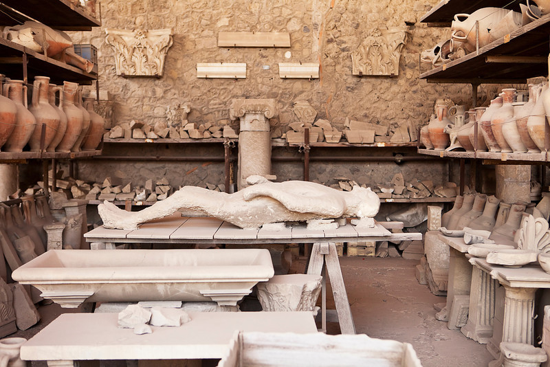 A plaster cast replica in an arcaheological working area of one of the Pompeii victims from the eruption of Mt. Vesuvius over 2000 years ago.