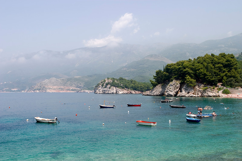 A harbor near the small town of Sveti Stefan in Montenegro is filled with small boats during the summer holiday travel season.