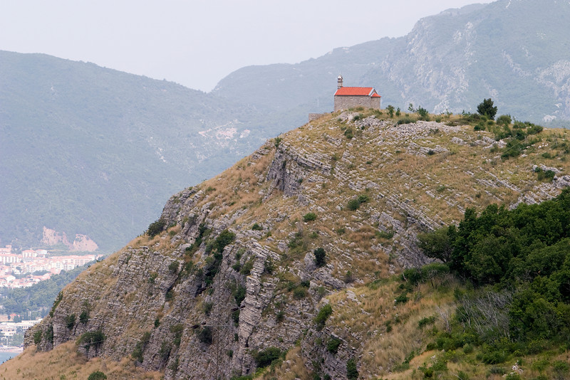 A small, one room church is located right at the edge of a rocky promontory on the Montenegro coast near Vrba and Sveti Stefan.