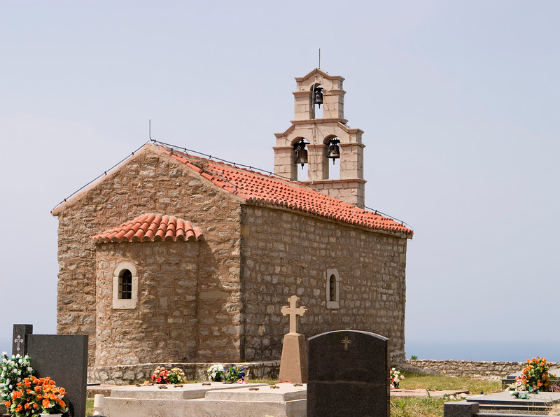 A small community hill church near the town of Vrba on the Montenegro coast. The stone church is built of stone and is partially surrounded by a small cemetery.