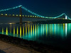 Night view of the April 25 (25 de Abril) Bridge in Lisbon, Portugal as seen from the Belem district. Completed in 1966 , this suspension bridge across the Tagus River is the longest central span in Europe. Originally named after dictator Salazar, the name was changed after the revolution of April 25, 1974.